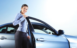 Business woman with her new company car will now have to pay benefit in kind company car tax