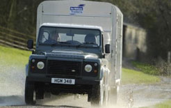 Land Rover Defender towing horsebox