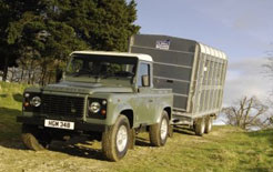 Land Rover Defender pick up towing horsebox