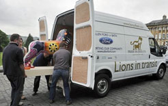 Lion sculptures being loaded into a long wheelbase Ford Transit in Bath