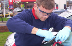 A National Mobile Windscreens technician fixes a windscreen