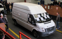Smith Edison electric van going through the auction hall at BCA Blackbushe. The electric van realised £10,100.