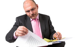 manager checking driver licences and employee documentation