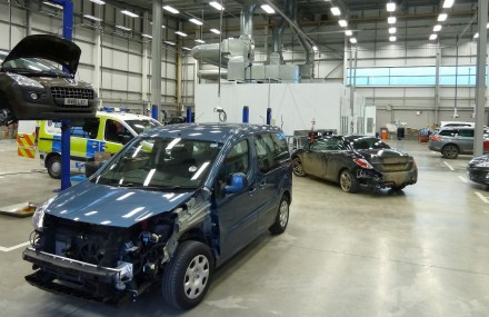 Damaged cars being repaired under an accident management scheme