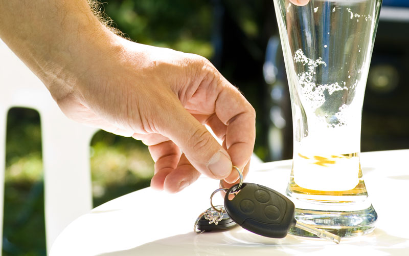 Man putting down beer and picking up car keys