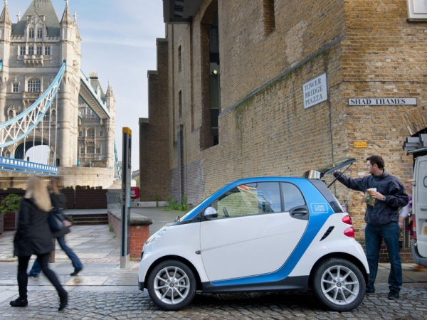 car2go business user with smart car near Tower Bridge