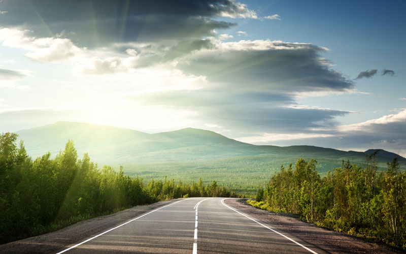 199_Low_dazzling_sun_over_country_road