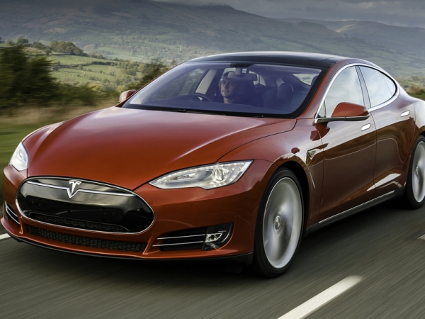 The first right-hand drive Model S versions have been delivered to UK buyers.