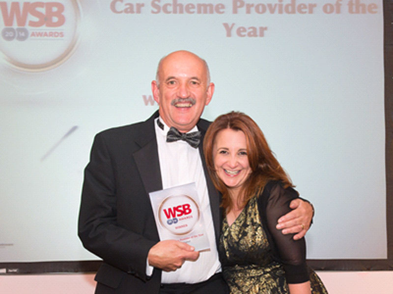 Nigel Trotman receives the award from comedian Lucy Porter