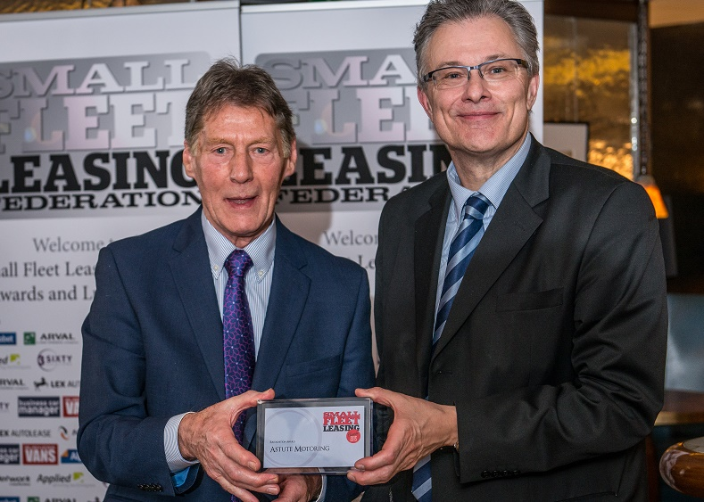 Peters Burkinshaw of Astute Motoring receives his special recognition award from Dr Jim Golby of ADT