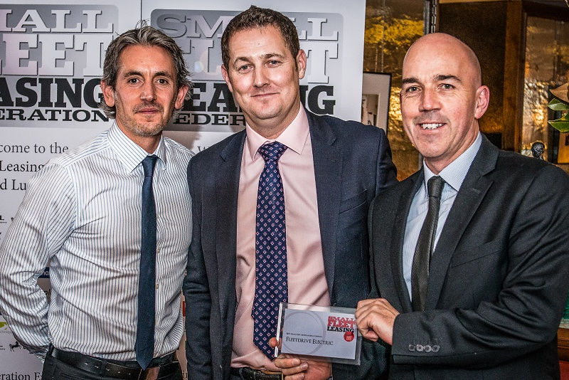 Adam-Kemp-and-Mike-Potter-of Fleetdrive Electric get the Gren Fleet award from Ty-Smith (centre)