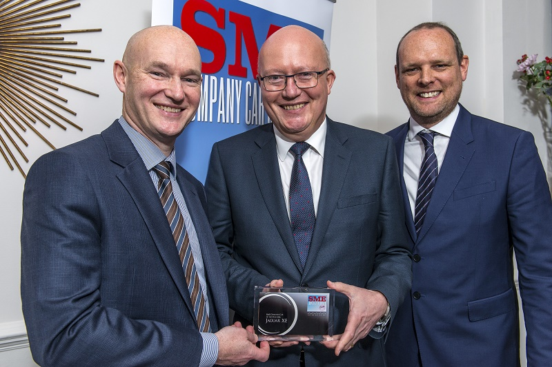 Jaguar's Jon Wackett, centrre, receives the SME Company Car of the Year Award from David Blackmore, left, commercial director of Fleet Alliance, and Paul Hollick, managing director TMC, who chaired the judging panel