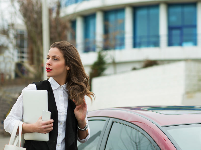 Business woman with a car bought on car finance