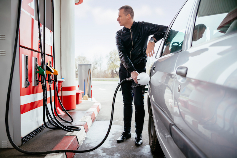 Man filling up with fuel