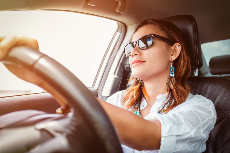 Woman at the wheel of a car on personal contract hire