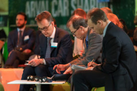 editor Ralph Morton (centre) takes notes at Arval conference