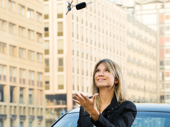 Business woman with car keys