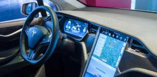 The forward thinking dashboard of the all-electric, luxury, crossover SUV Tesla Model X. credit: Sergey Kohl / Shutterstock.com